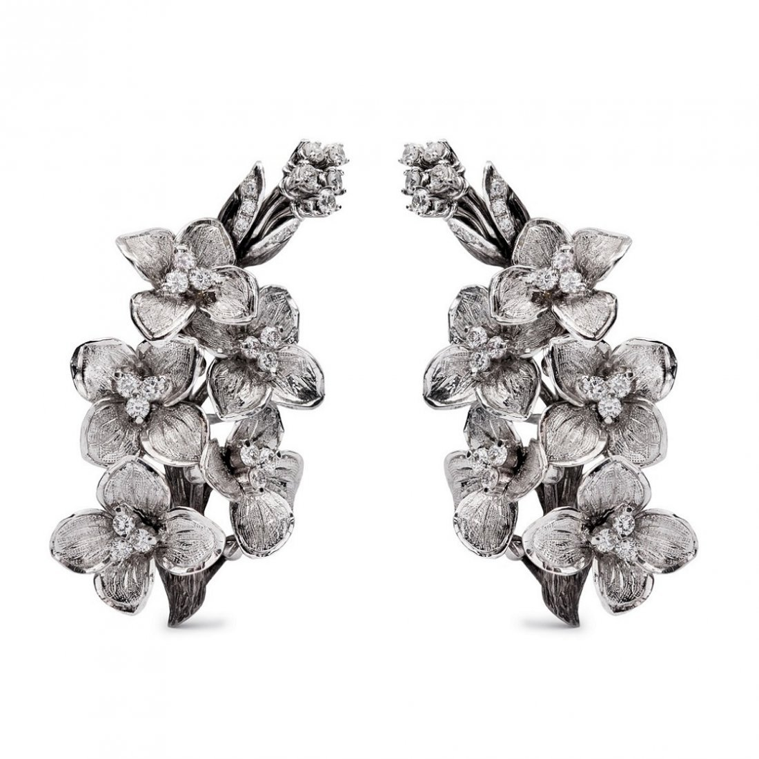 A pair of floral brooches with diamond accents