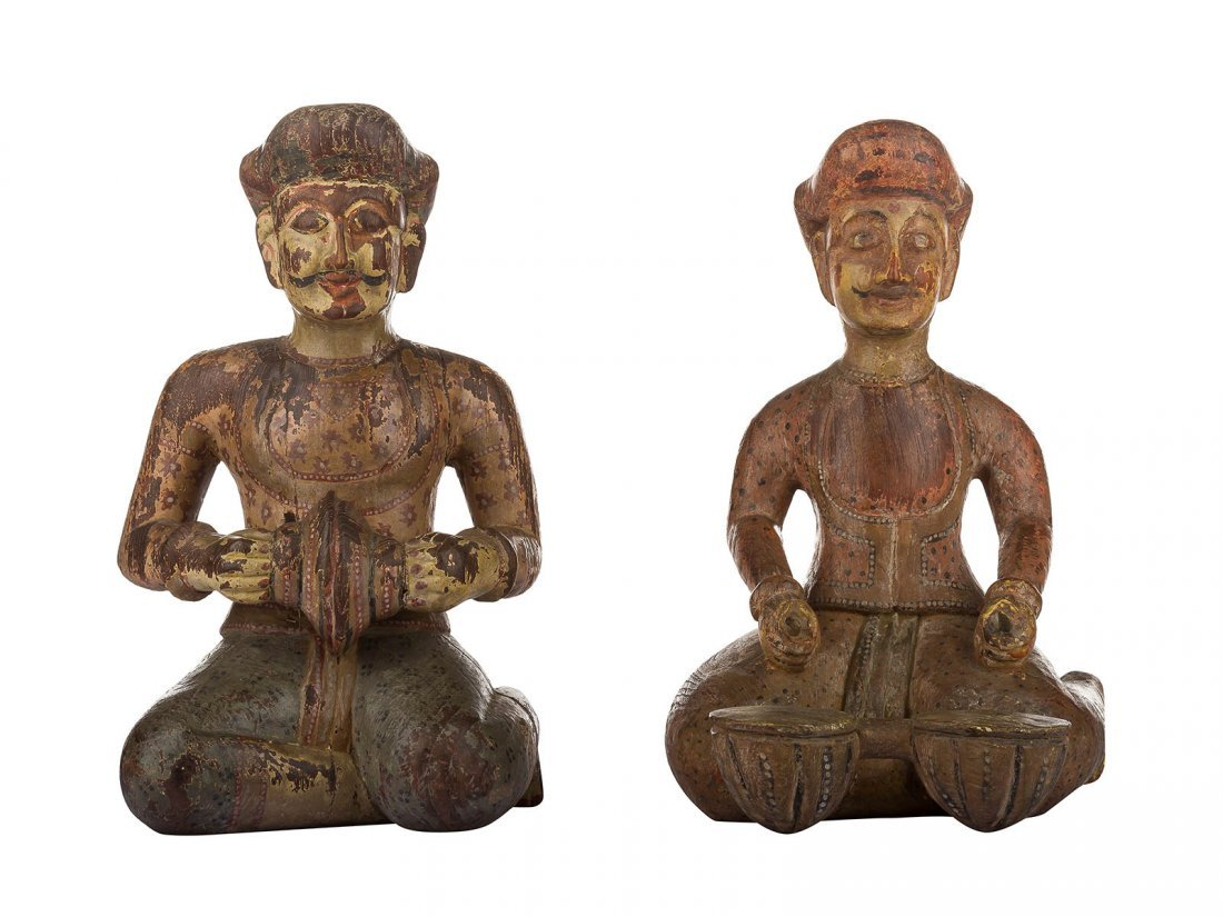 A pair of polychrome wooden musician figurines, India
