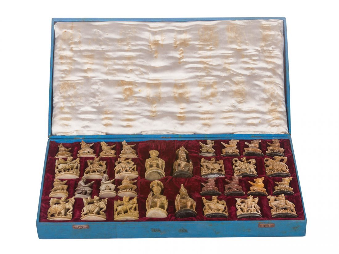 A Mughal warrior motif chess set in stone, possibly