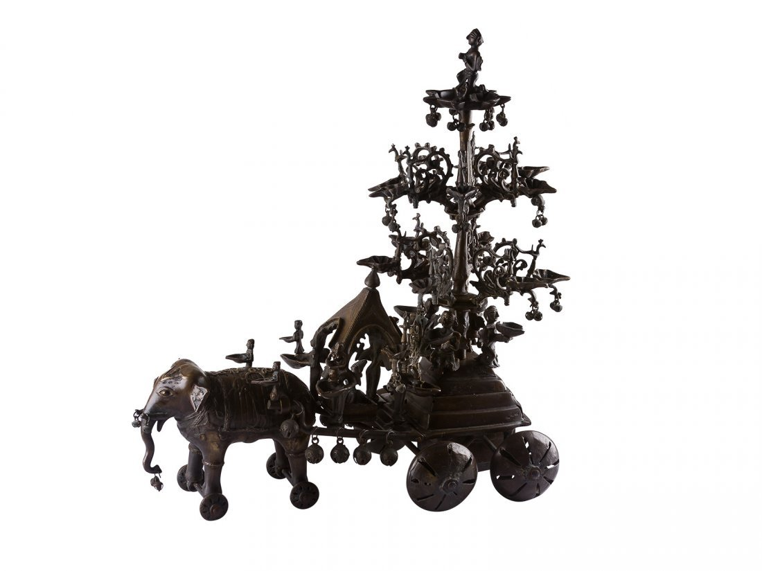 A bronze elephant oil lamp carousel, possibly antique,