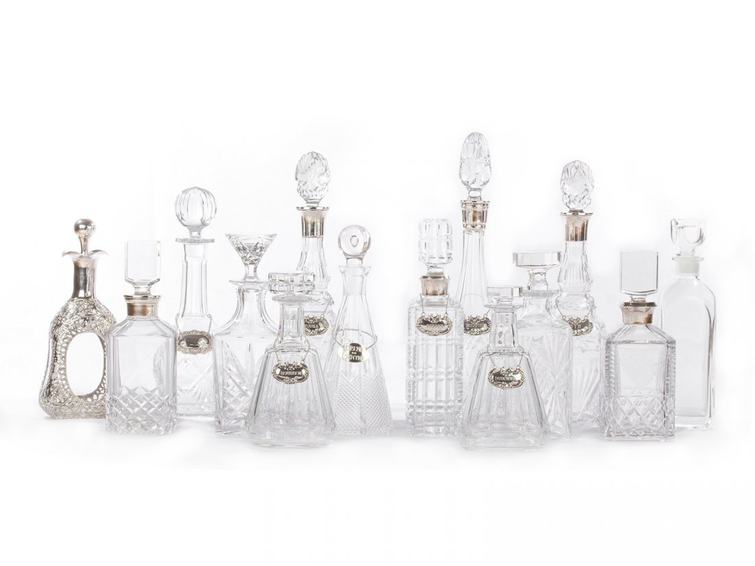 A lot of 14 exquisite crystal decanters