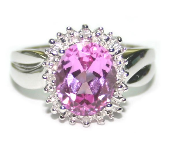 4023: 3.50 CT DIA & PINK TOPAZ 10K RING