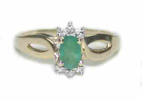 2160: 0.75 CT DIA & EMERALD 2.25 GR 10K GOLD RING.