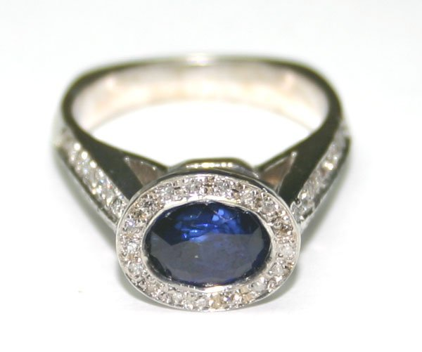 5017: 3.CT DIA & SAPPHIRE 6.70 GR 14K GOLD RING.