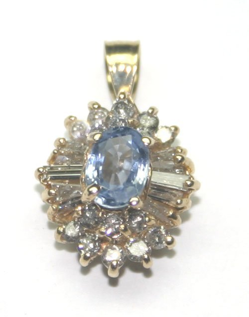 2014: 2 CT DIAMOND & TANZANITE 14KT GOLD PENDANT.