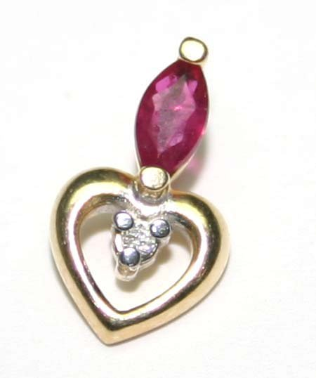 2023: 0.30 CT DIAM & RUBY 14 kt GOLD PENDANT.