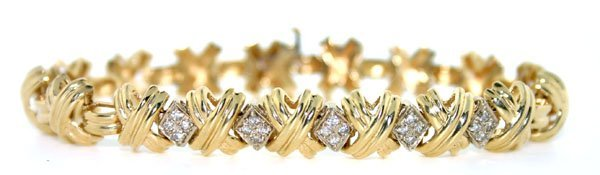 2144: 0.50 CT DIAMOND 18.30 GR 14KT GOLD BRACELET.