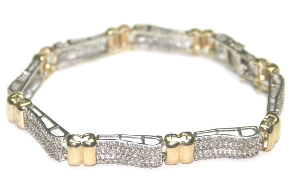 4690: 3,CT DIAMOND 13.50 GR  10KT GOLD  BRACELET.