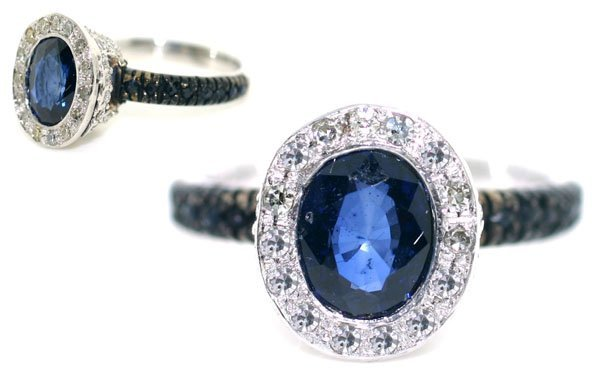 5666: 3 CT DIAMOND & SAPPHIRE 4.60 GR 14KT GOLD RING.
