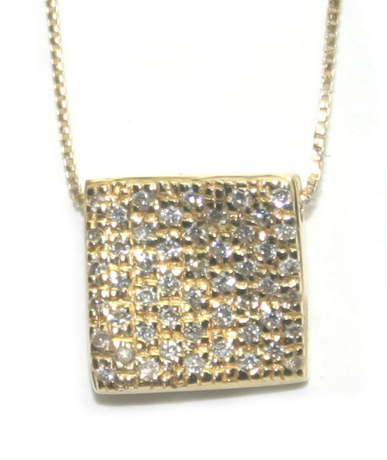 5004: 0.60 CT DIAMOND 4.60 GR 18KT GOLD PENDANT.