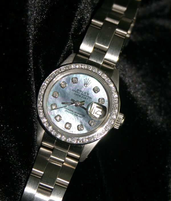 1022: LADY'S ROLEX DIAMOND DIAL & BEZEL DATE WATCH .