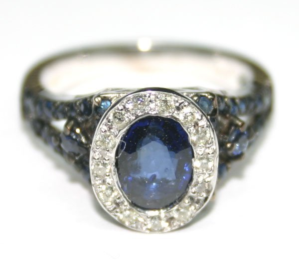 2099: 3. CT DIAM & SAPPHIRE 5.30 GR 14kt GOLD RING.