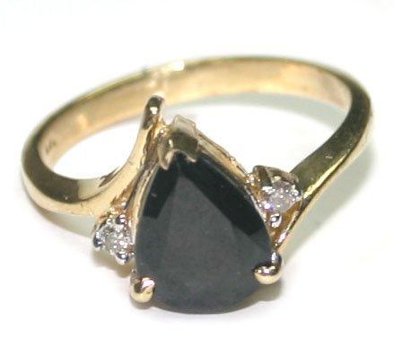 1002: 1,50 CT  DIAMOND & SAPPHIRE 14 KT GOLD RING .