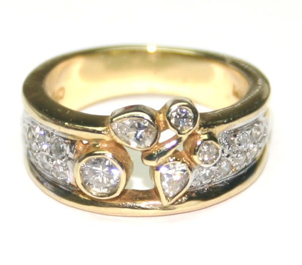 1010: 1,CT DIAMOND  6.80 GR 14KT GOLD RING .