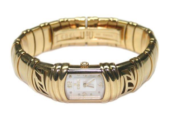 3595: LADY'S EBEL  SWISS 18KT GOLD  WATCH 128 GR .