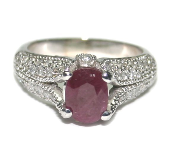 5012: 2.50 CT DIAMOND & RUBY 5.80 GR 14KT GOLD RING.