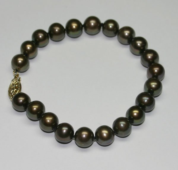2010: 9 mm  FRESH WATER PEARLS BRACELET .