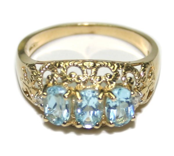2014: 2,CT BLUE TOPAZ 14KT GOLD RING 3.50 GR .