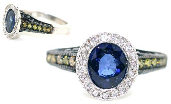5533: 3 CT DIAMOND & SAPPHIRE 4.20 GR 14KT GOLD RING.