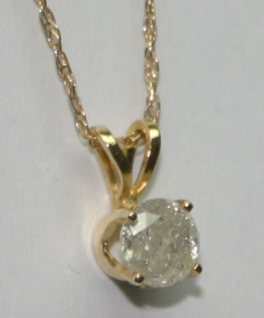 2012: 0.50 CT  DIAMOND  14KT  GOLD  PENDANT .