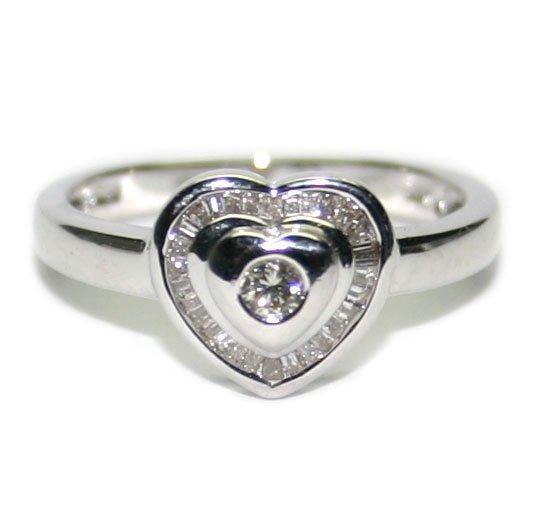 3011: 0.75 CT DIAMOND  HEART 14KT GOLD  RING  .