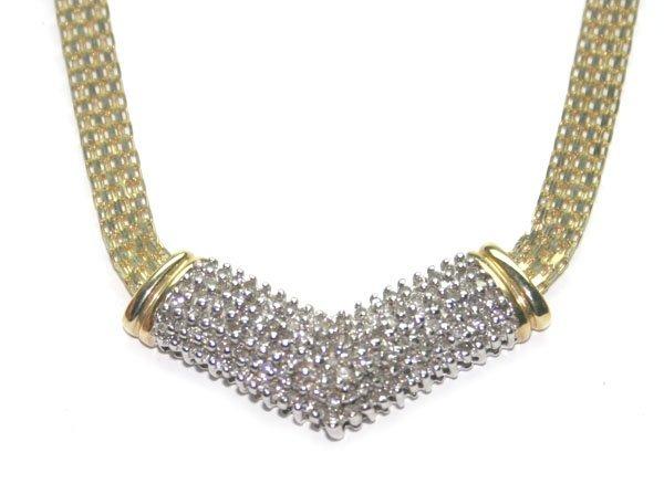 4027: 1 CT DIAMOND 12 GR 10KT GOLD NECKLACE .