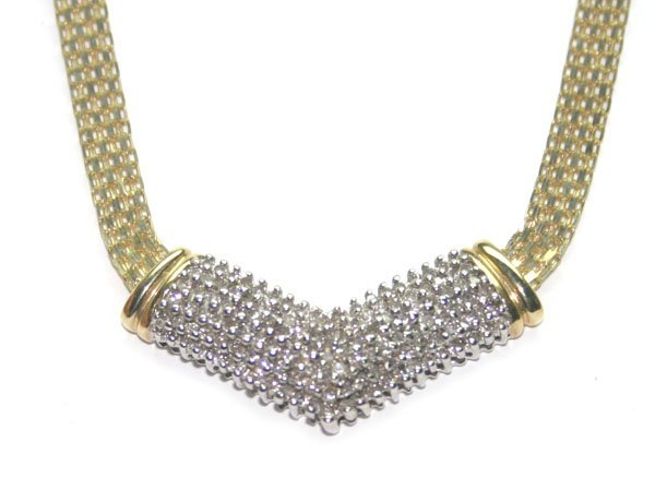 4027: 1 CT DIAMOND 12 GR 10KT GOLD NECKLACE .