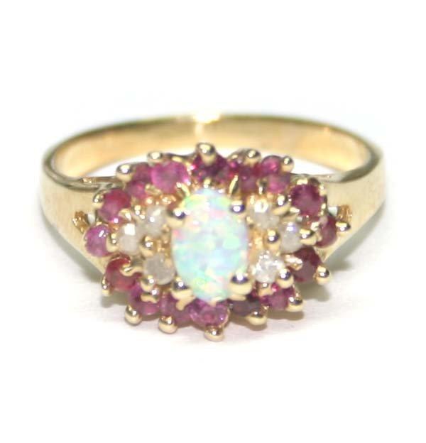 1479: DIAMOND ,RUBY & OPAL 14K GOLD RING .