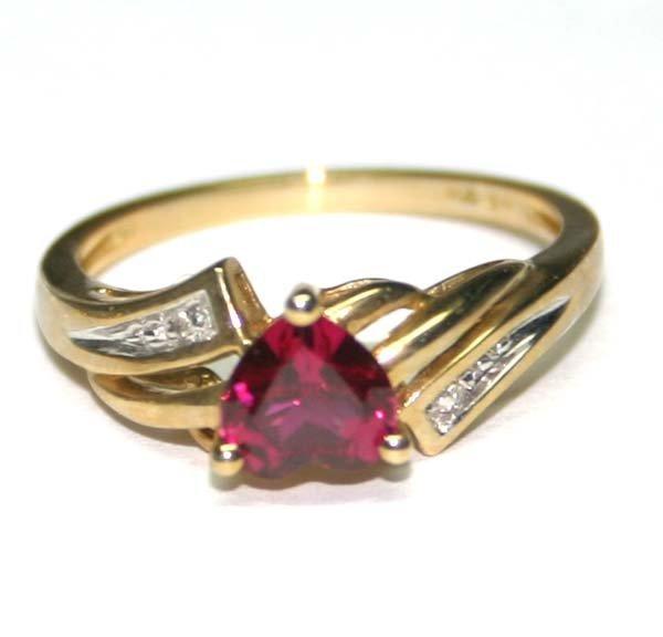 1002: DIAMOND & LAB RUBY 10K GOLD RING .