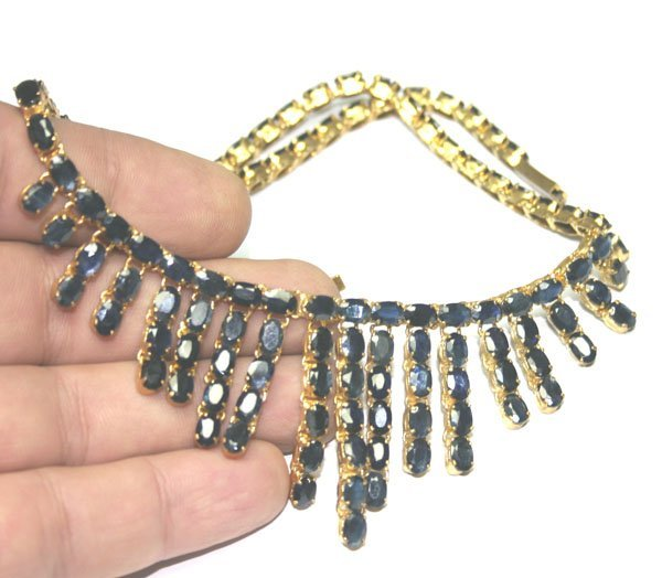 3036: 120,CT SAPPHIRE  18KT GOLD NECKLACE .