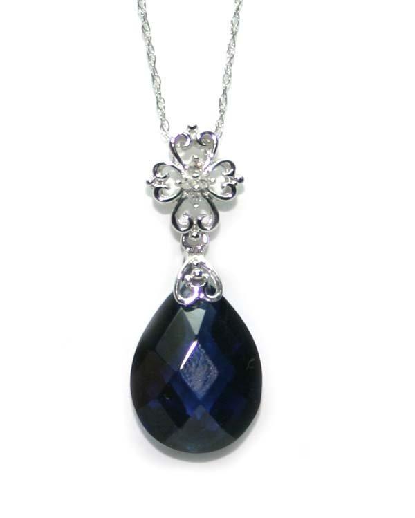 4013: DIAMOND & LAB BORLITE SAPPHIRE GOLD PENDANT.
