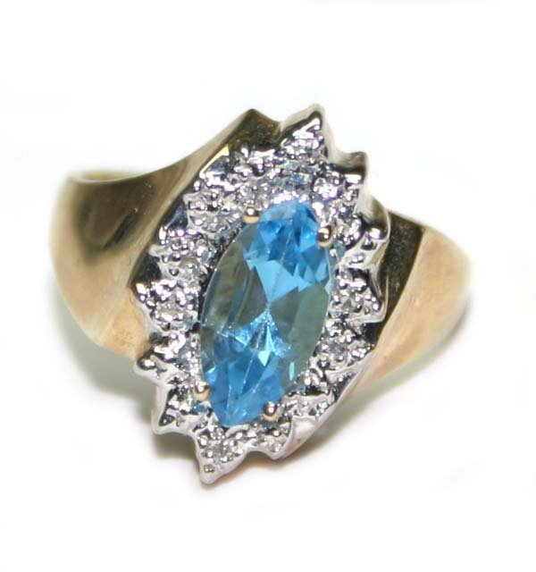 5014: 0.70 CT DIAMOND & BLUE TOAPZ 10K GOLD RING .