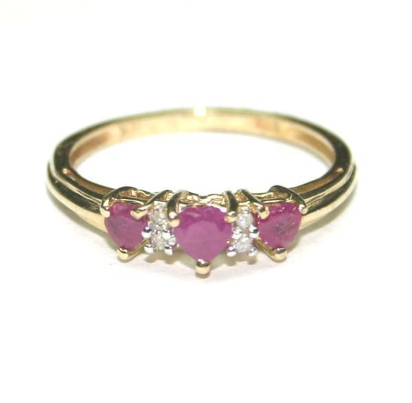 2003: 0.55 CT DIAMOND & RUBY 10KT GOLD RING .