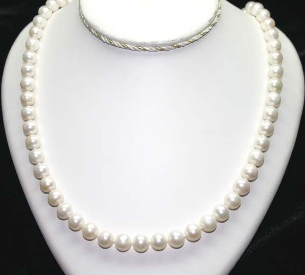 2292: 24'' INCHS  9-10 MM  FRESH WATER PEARL NECKLACE .