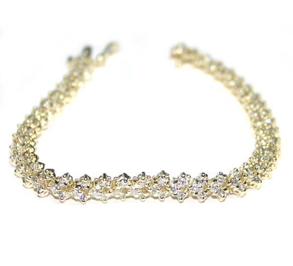 1020: 3,CT DIAMOND 14KT GOLD BRACELET 14GR.