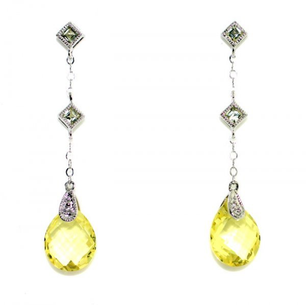 3003: 4,CT PERIDOT  10KT  GOLD POST  EARRINGS .