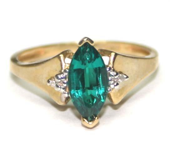 1014: DIAMOND & LAB  EMERALD  10K GOLD RING .