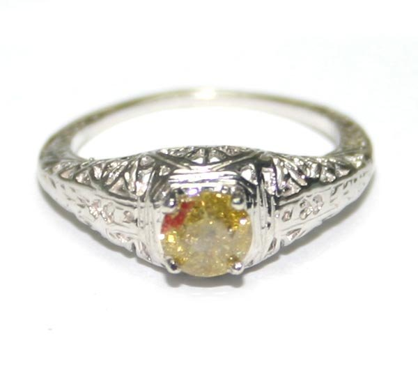 5007: GENUINE 0.50 CT DIAMOND  14K GOLD  RING .