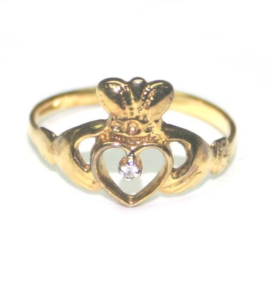 1028: GOLD PLATED SILVER RING  WITH DIAMOND .