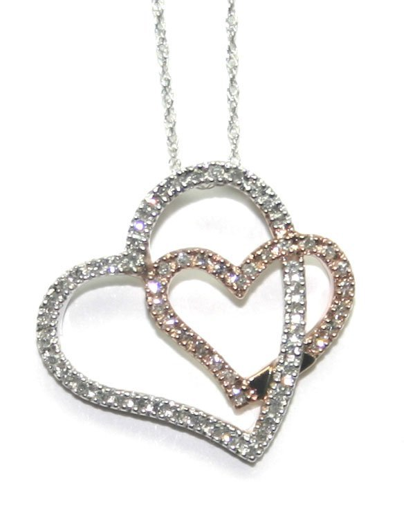3001: 0.80 CT DIAMOND 2-TONE GOLD HEART PENDANT.