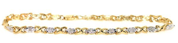 3006: 0.10 CT DIAMOND 2.80 GRAMS 10KT GOLD BRACELET.