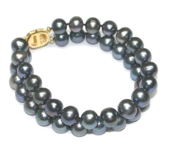 3008: 9 mm  FRESH WATER PEARLS BRACELET .