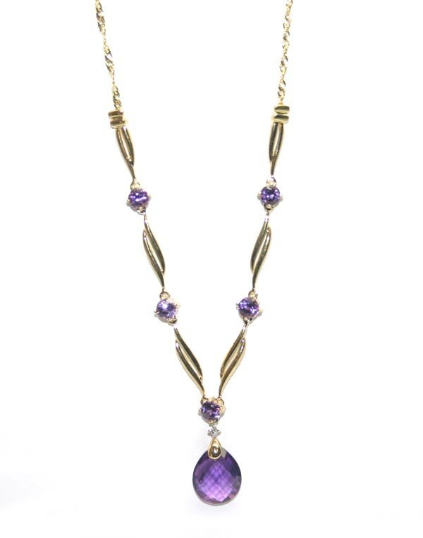 2009: 6,CT AMETHYST  10K GOLD NECKLACE 6.20 GR .