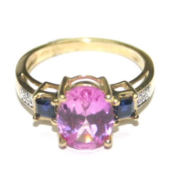 5017: 3,CT PINK TOPAZ & SAPPHIRE 10K GOLD RING .