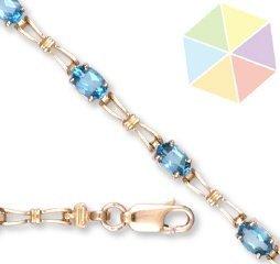 6: Yellow Gold Blue Topaz 10K Bracelet