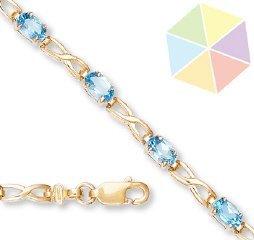12: Yellow Gold Blue Topaz 10K Bracelet