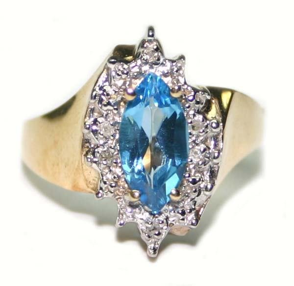 3008: 0.80 CT DIA & B.TOPAZ  GOLD RING.