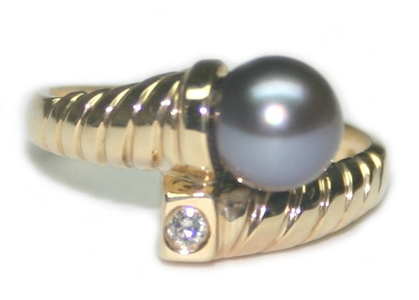 1014: 3.54 GR 14K  GOLD DIA & 7mm PEARL RING.