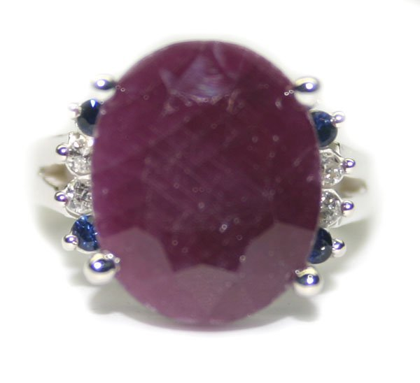 4002: 9. CT NATURAL RUBY & DIA SILVER RING.
