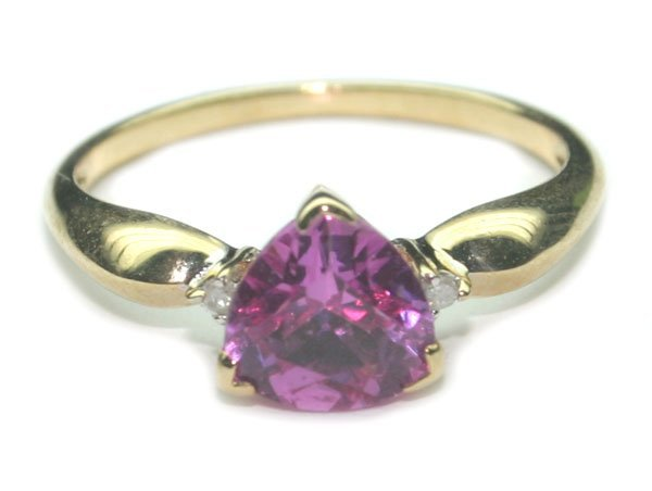 2016: 1.CT DIA & PINK TOPAZ  1.90 GR 10K GOLD RING.